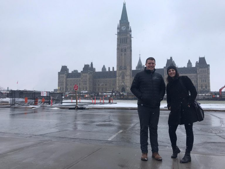 ISC's David Dutkiewicz and Mackenzie DiGasparro in front of Parliament in Ottawa, Ontario.