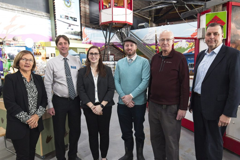 ISC Executive Director Sarah Rang with Canadian Bushplane Heritage Centre Executive Director Dan Ingram, ISC's Leah Hodgson, Sault Ste. Marie Public Library CEO Matthew MacDonald, Canadian Bushplane Heritage Centre Board President Bob Elliott, and Science North CEO Guy Labine at the launch of the invasive species exhibit at the Canadian Bushplane Heritage Centre.